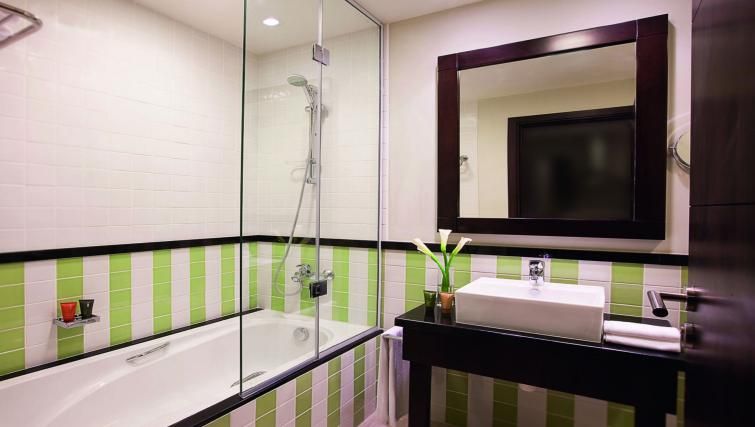 Bathroom at Moevenpick Al Mamzar Apartments - Citybase Apartments