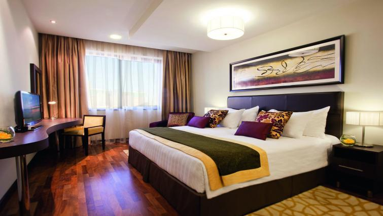 Bed at Moevenpick Al Mamzar Apartments - Citybase Apartments