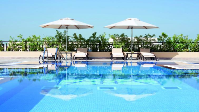 Pool at Moevenpick Al Mamzar Apartments - Citybase Apartments