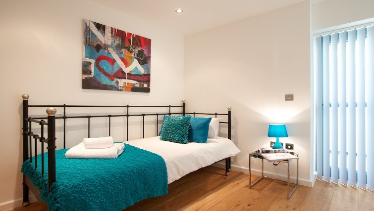 colourful bright bedroom at Flying Butler Marylebone Edgware Road Apartments - Citybase Apartments