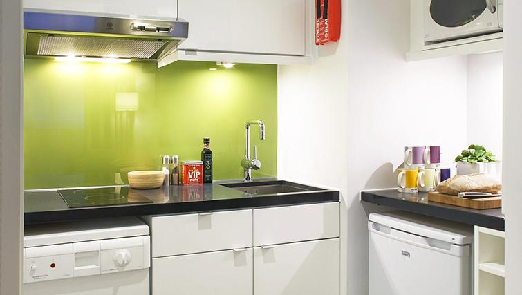 Modest kitchen at the Citadines Holborn & Covent Garden London - Citybase Apartments