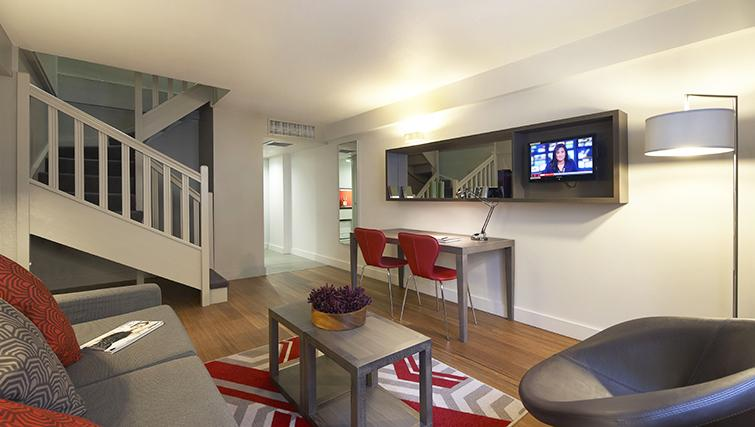 Living area in a 1 bed at Citadines Trafalgar Square Apartments - Citybase Apartments