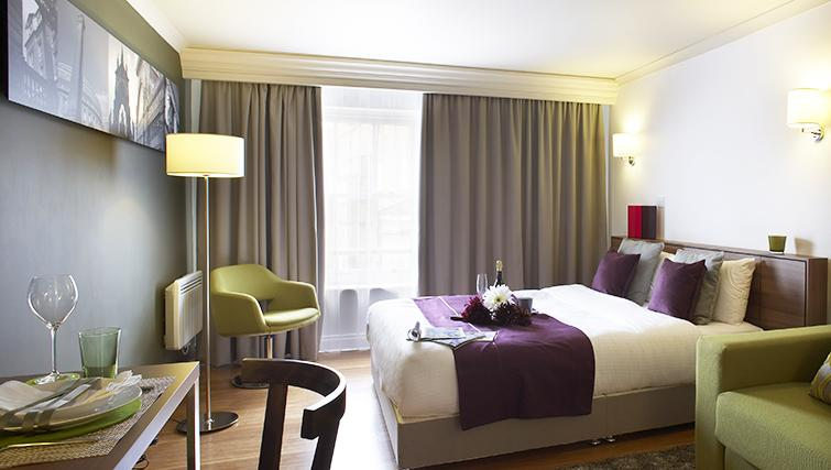 Comfortable bedroom at Citadines South Kensington Apartments - Citybase Apartments
