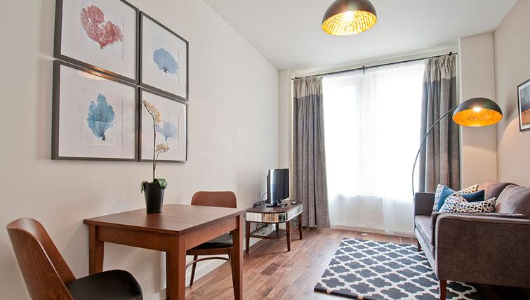 Spacious living room at Native Monument Apartments - Citybase Apartments