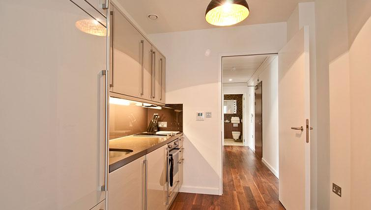 Kitchen at Native Monument Apartments - Citybase Apartments
