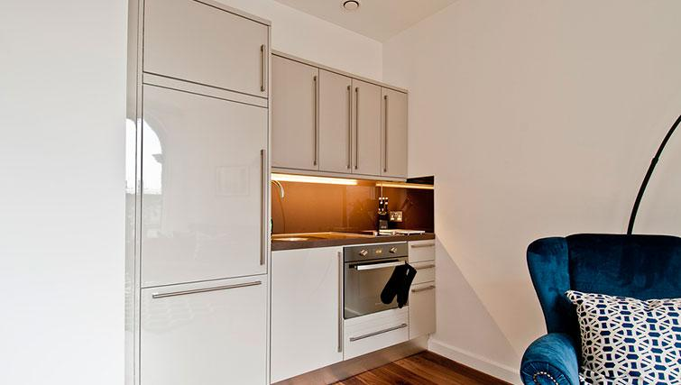 Equipped kitchen at Native Monument Apartments - Citybase Apartments