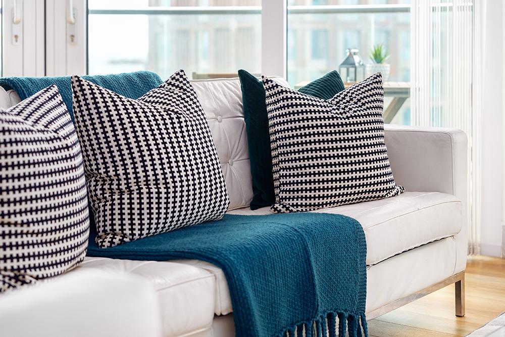 Sofa at Altitude Point Apartments - Citybase Apartments