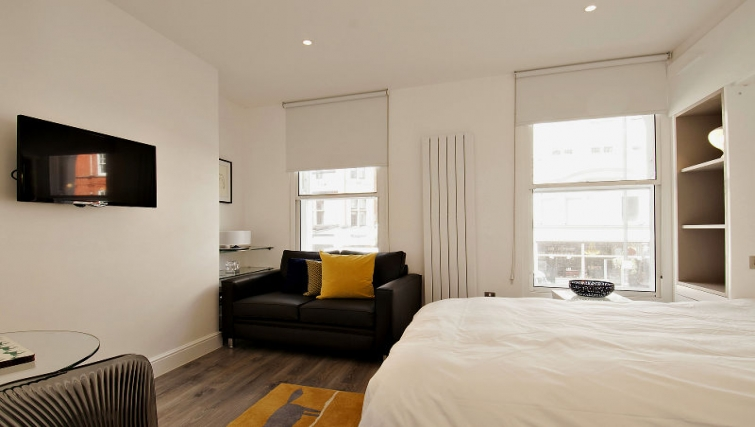 Stylish bedroom at Wigmore Street Apartments - Citybase Apartments