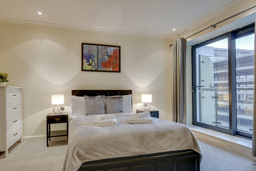 Bedroom at Discovery Dock West - Citybase Apartments