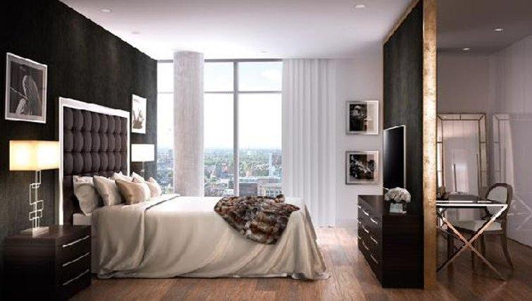 Stylish bedroom at Oakwood Commercial Street - Citybase Apartments