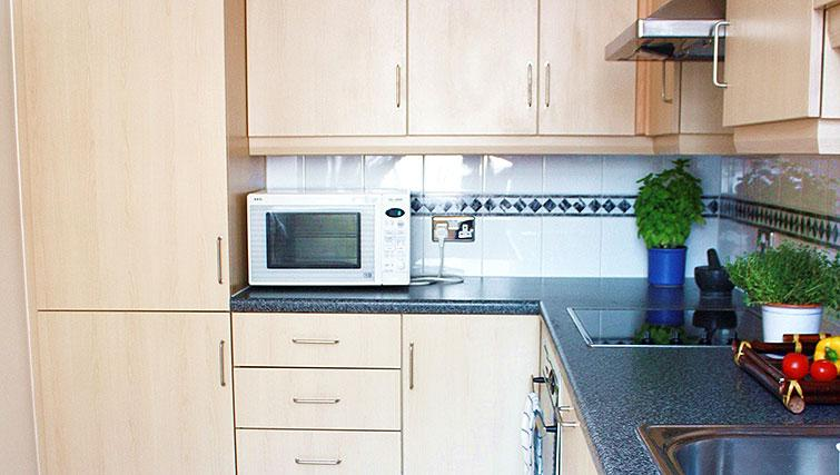 Equipped kitchen at Astral House Apartments - Citybase Apartments