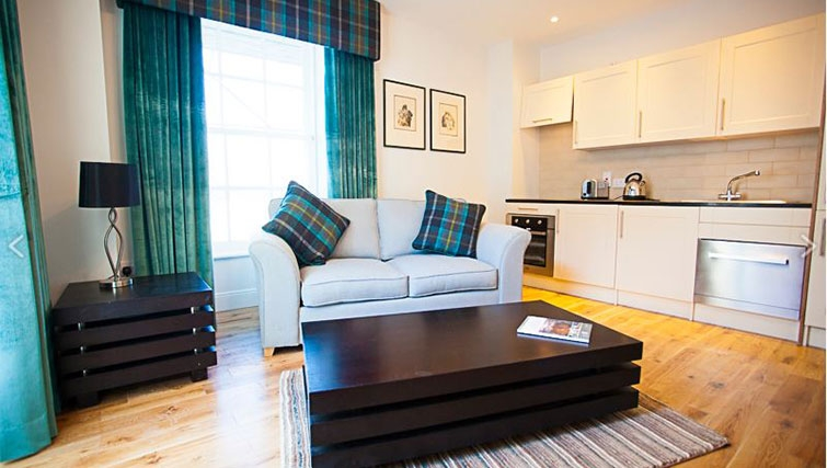 Bright living area at Royal Athenaeum Suites - Citybase Apartments
