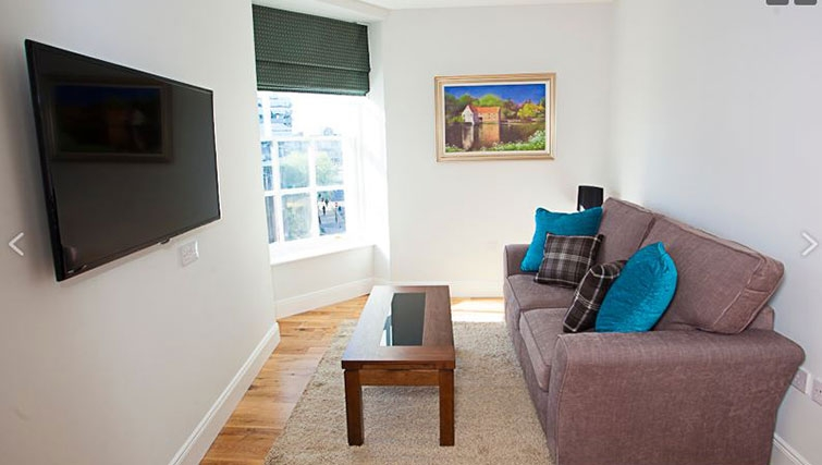 Living area at Royal Athenaeum Suites - Citybase Apartments