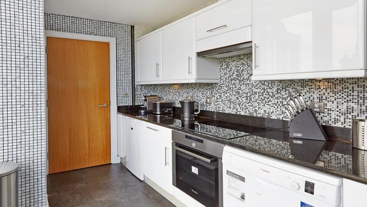 Kitchen at Cheval Harrington Court - Citybase Apartments