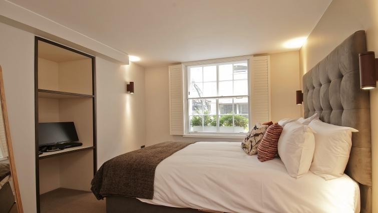Bright bedroom in Wigmore Suites - Citybase Apartments
