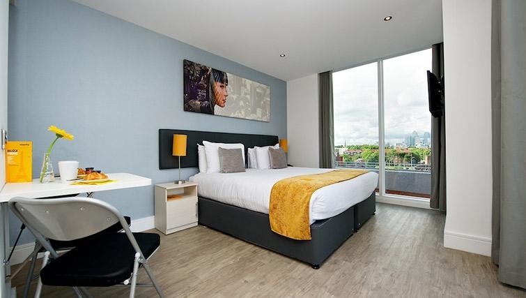 Colourful bedroom at Staycity London Deptford Bridge - Citybase Apartments