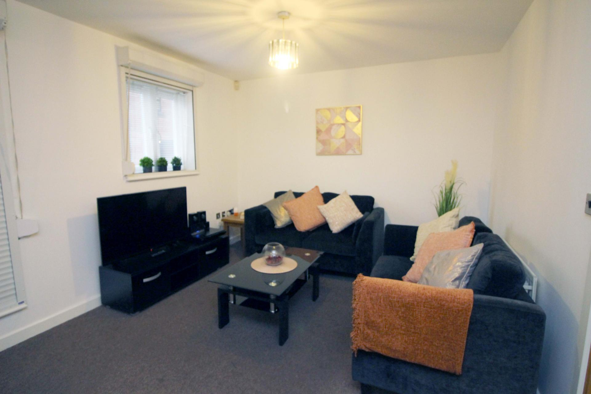 Living area at Bakers Court Apartment - Citybase Apartments
