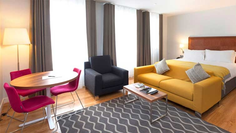 Living area at Premier Suites Dublin Ballsbridge - Citybase Apartments