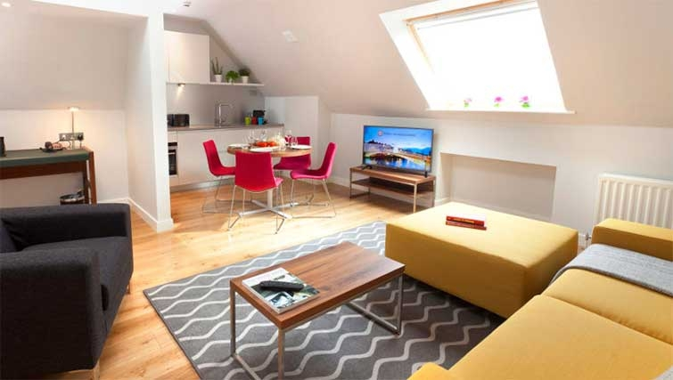 Open-plan living area at Premier Suites Dublin Ballsbridge - Citybase Apartments