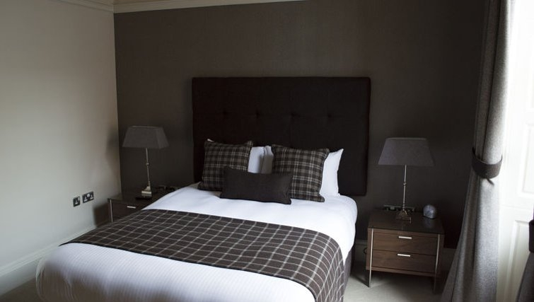 Tranquil bedroom at Blythswood Apartments - Citybase Apartments