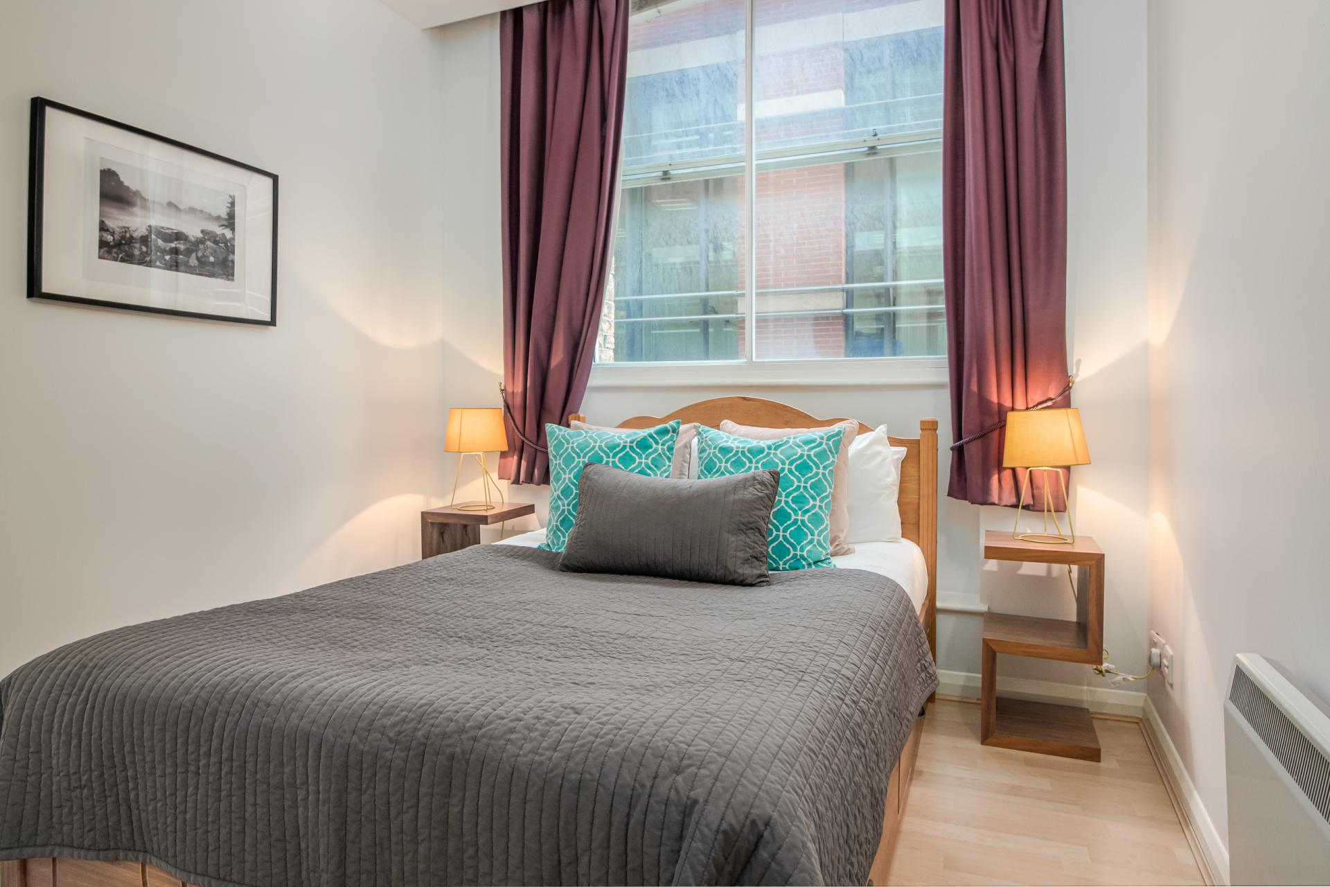 Bright bedroom at Priory House Apartments, City, London - Citybase Apartments