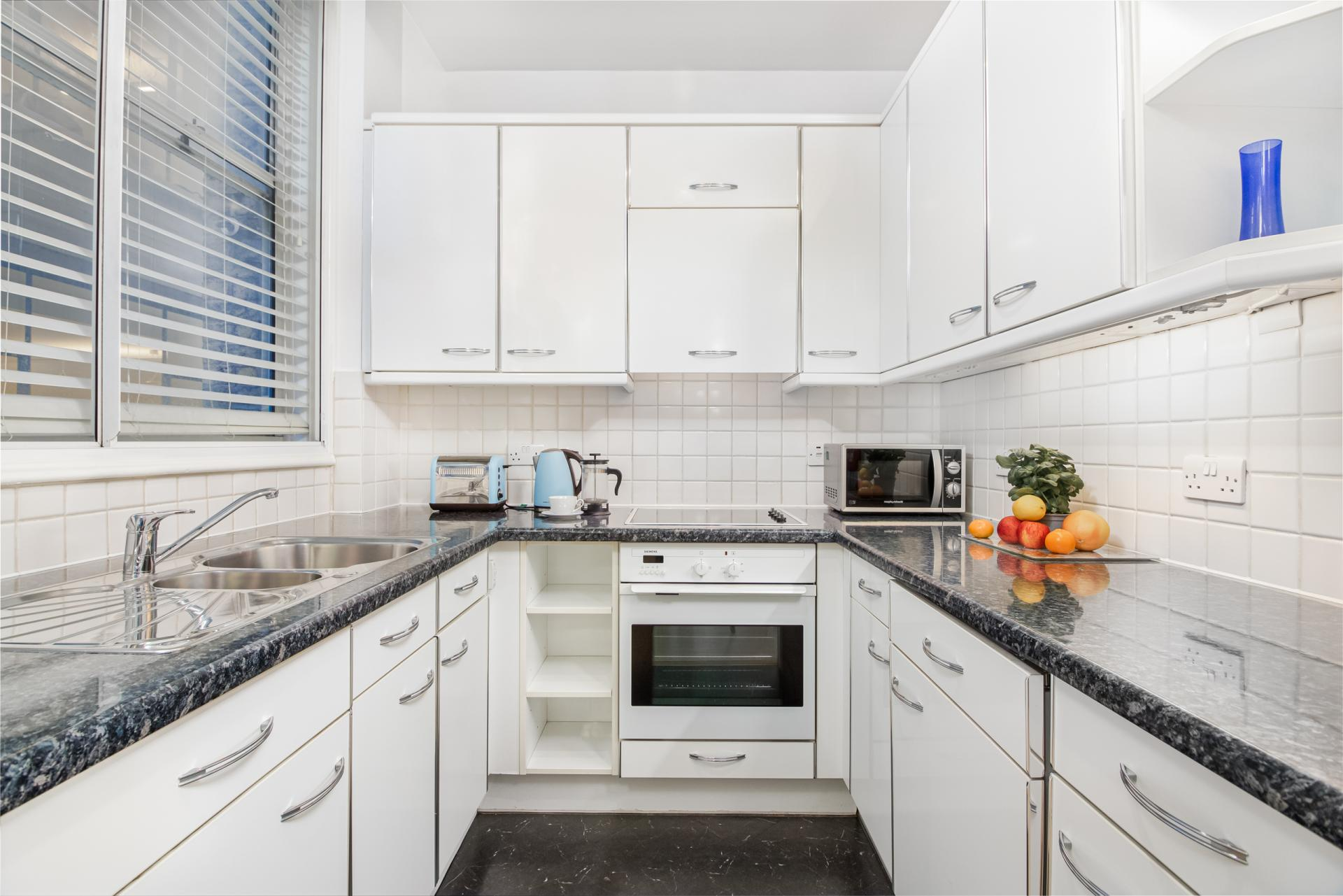 Sleek kitchen at Priory House Apartments, City, London - Citybase Apartments