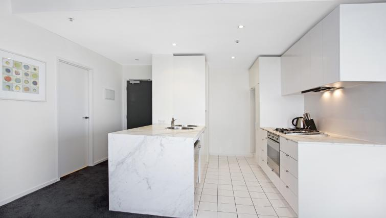 Kitchen area at Astra Melbourne CBD Liberty Tower - Citybase Apartments