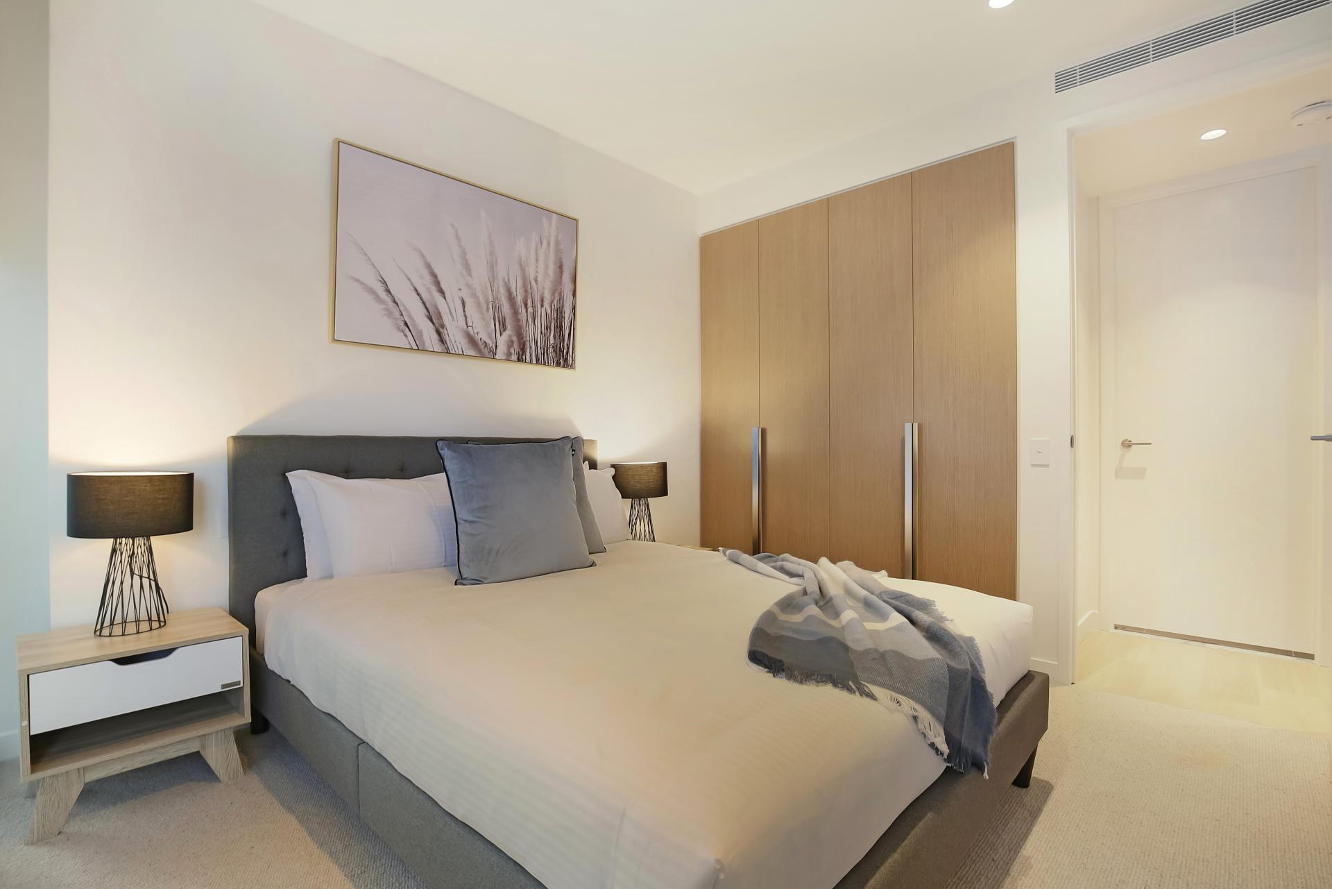 Bed at Astra Melbourne CBD Liberty Tower - Citybase Apartments
