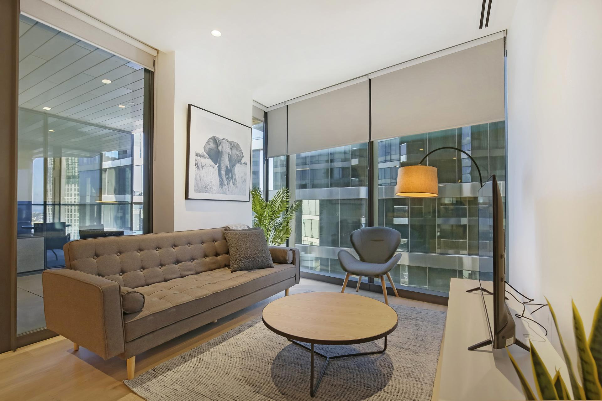 Living room at Astra Melbourne CBD Liberty Tower - Citybase Apartments