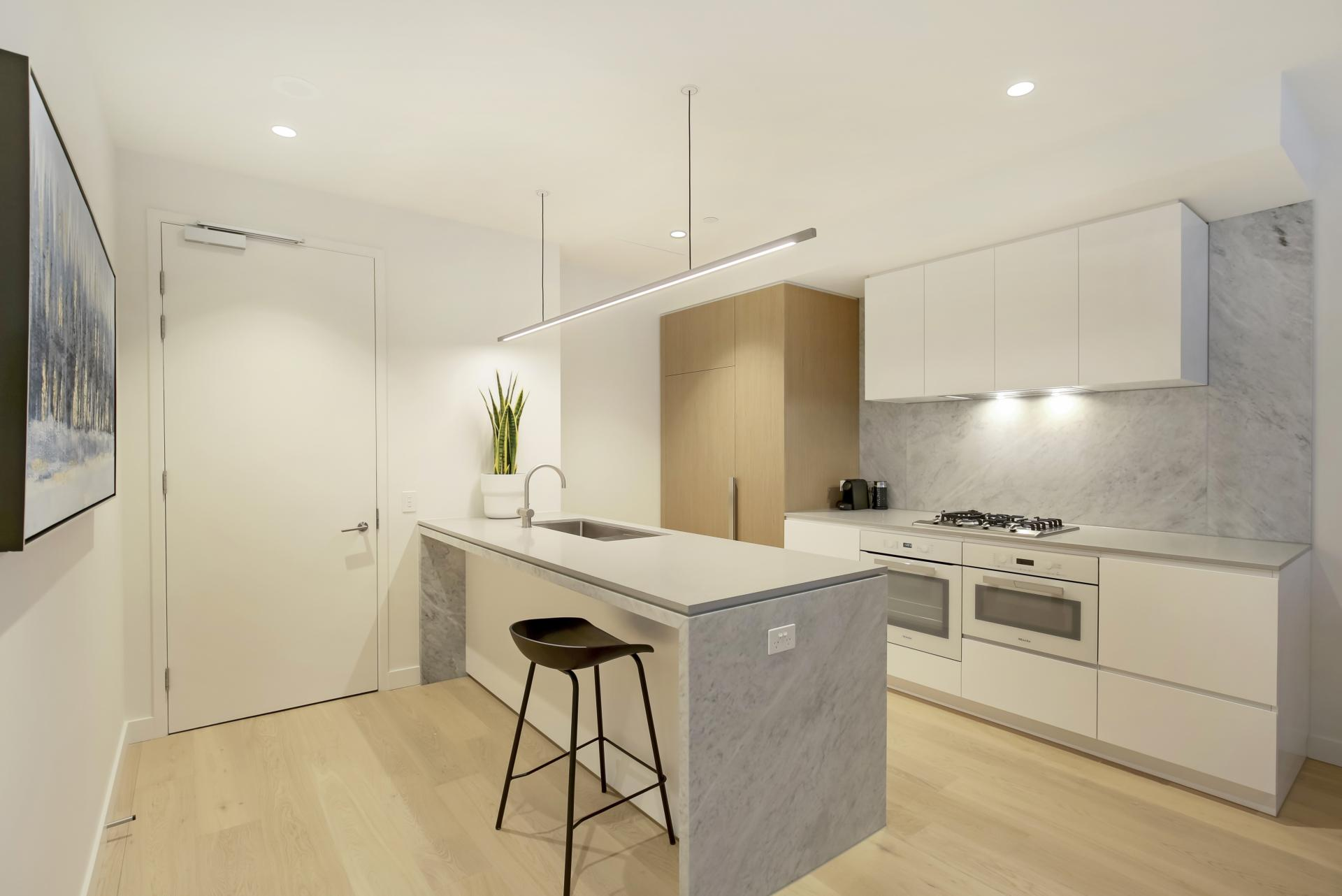 Kitchen island at Astra Melbourne CBD Liberty Tower, Centre, Melbourne - Citybase Apartments