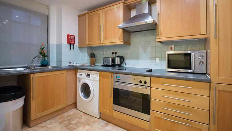 Equipped kitchen at Monument Apartment - Citybase Apartments