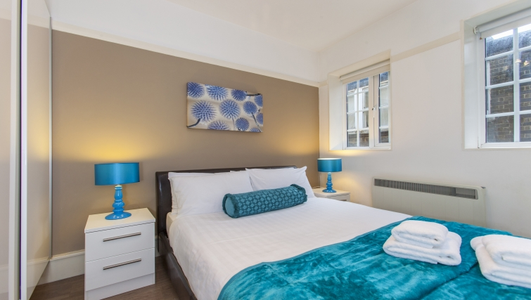 Comfy bedroom at Liverpool Street Apartments - Citybase Apartments