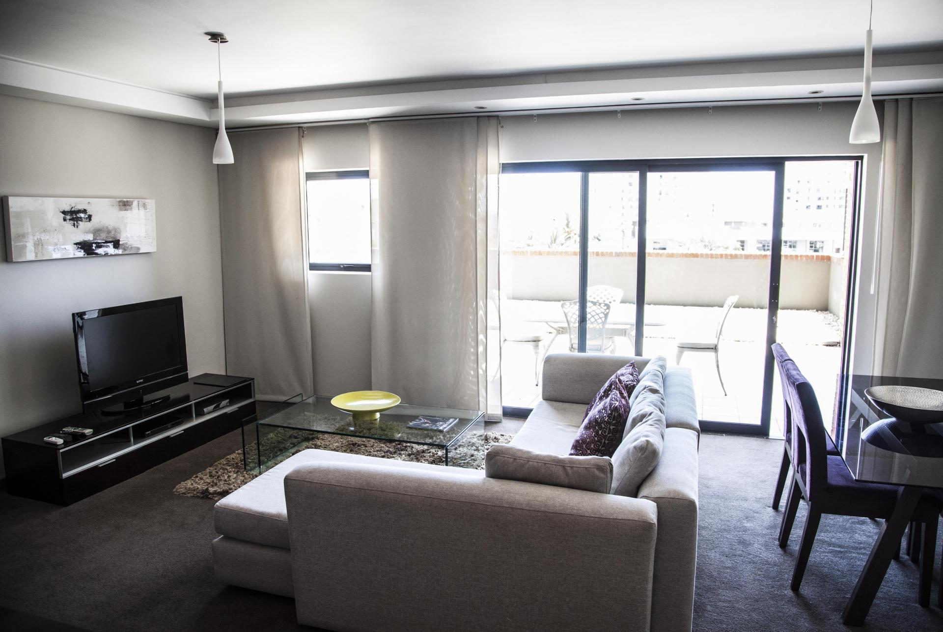 Bright living space at Manhattan Suites & Conferences - Citybase Apartments