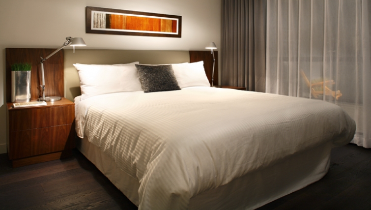 Bedroom at Level Furnished Living - Citybase Apartments