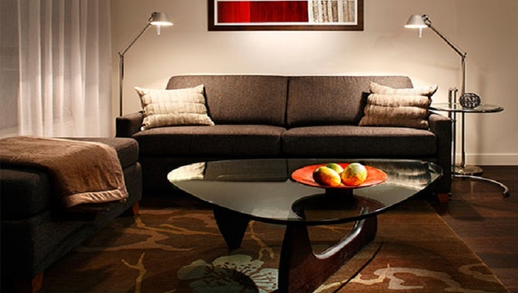 Level suite living area in Level Furnished Living - Citybase Apartments