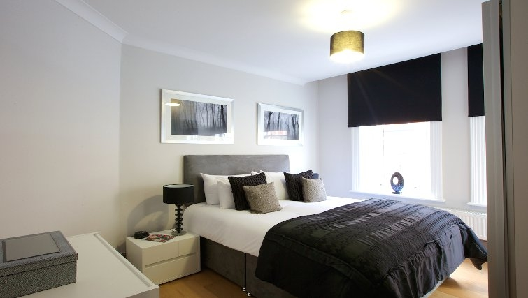 Large bedroom at Flying Butler Fitzrovia Apartments - Citybase Apartments