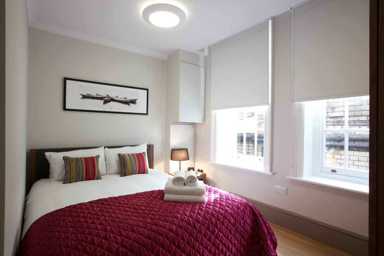 Bed at Flying Butler Fitzrovia Apartments - Citybase Apartments