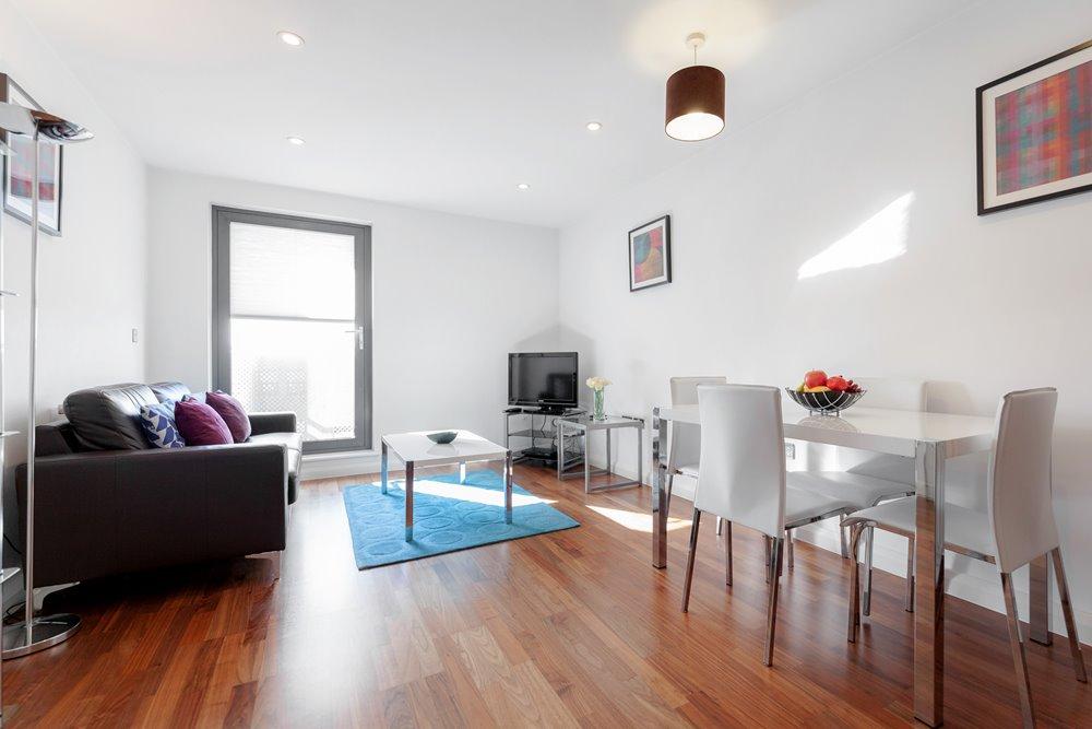 Living/dining area at Chorus Apartment - Citybase Apartments