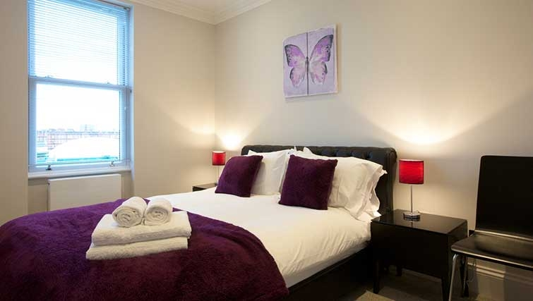 Bedroom at Flying Butler Ongar Road Apartments - Citybase Apartments