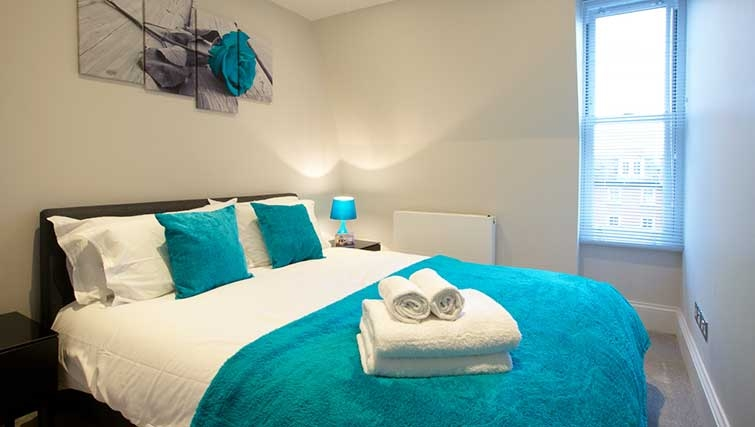 Double bedroom at Flying Butler Ongar Road Apartments - Citybase Apartments