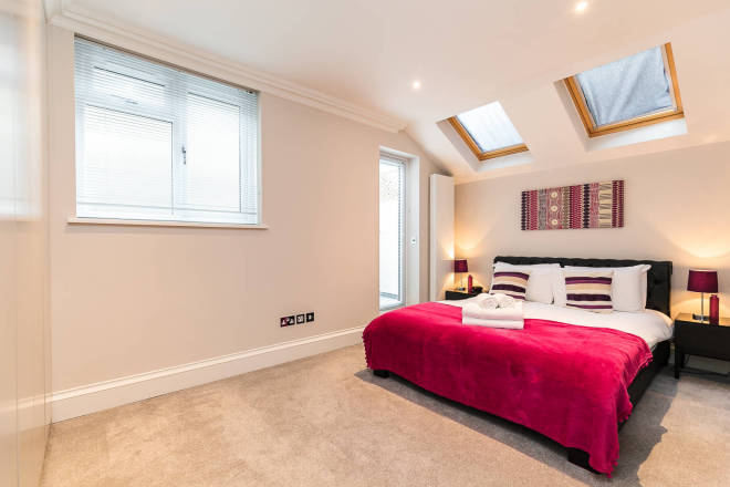 Spacious bedroom at Flying Butler Ongar Road Apartments - Citybase Apartments