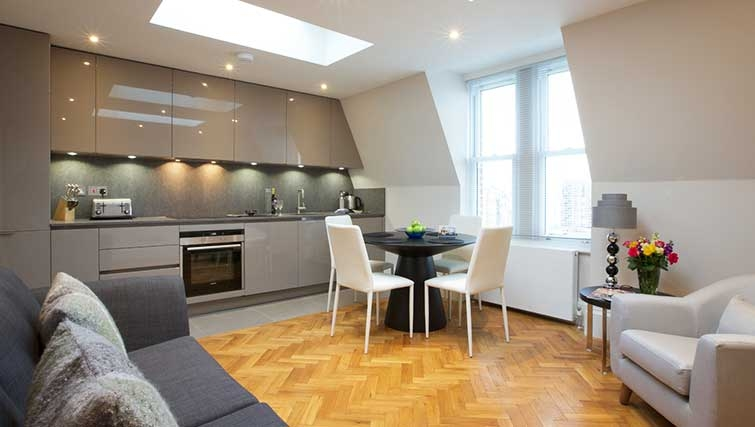 Living and kitchen area at Flying Butler Barons Court Apartments - Citybase Apartments