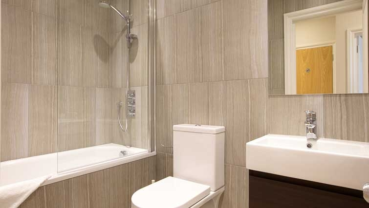 Modern bathroom at Flying Butler Barons Court Apartments - Citybase Apartments