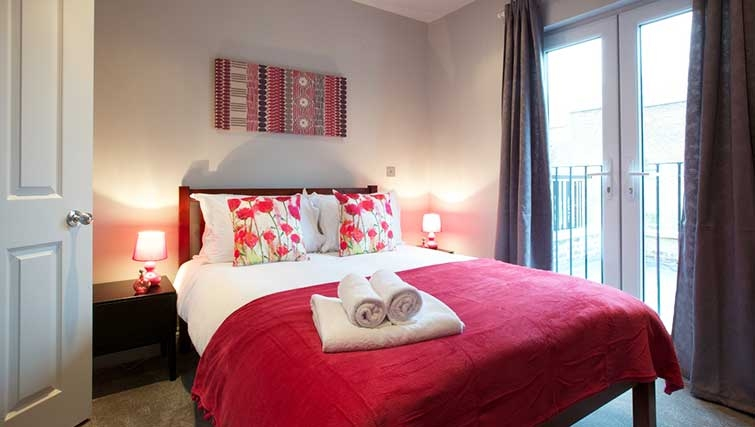 Bedroom at Flying Butler Hammersmith Apartments - Citybase Apartments
