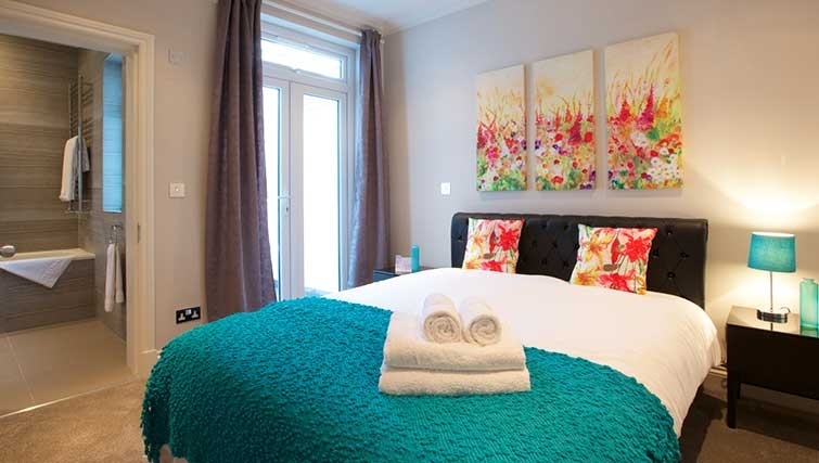 Modern bedroom at Flying Butler Hammersmith Apartments - Citybase Apartments