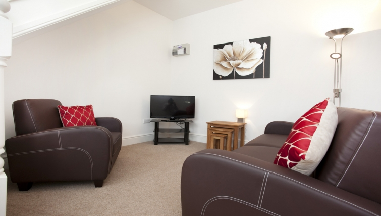 Living area at Musters Cottage - Citybase Apartments
