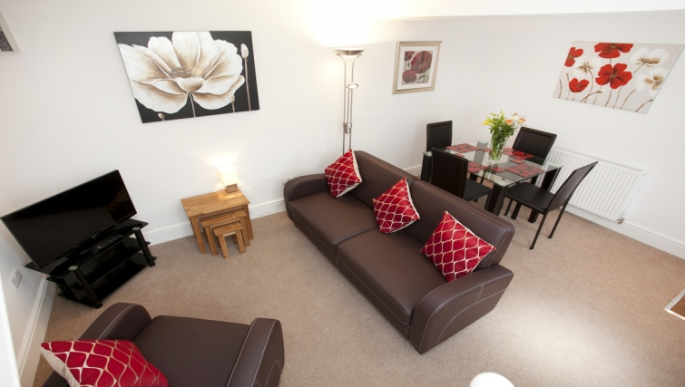 Living/dining area at Musters Cottage - Citybase Apartments