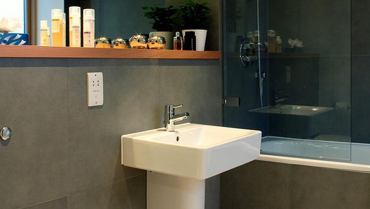 Bathroom at Phoenix Heights Apartments - Citybase Apartments