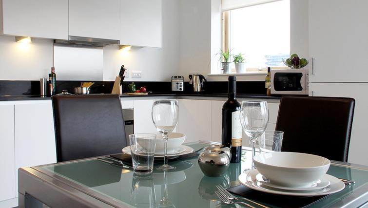 Dining table at Phoenix Heights Apartments - Citybase Apartments