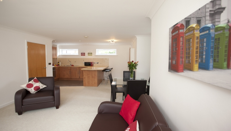 Living/kitchen area at Cricket Heaven Apartment - Citybase Apartments